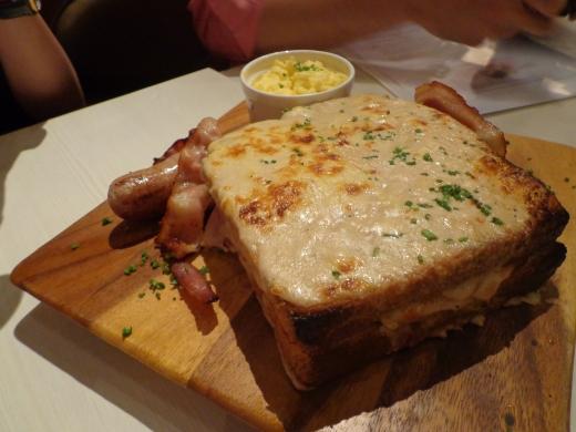 Le Jolly Monsieur (French) - Ham, bacon, Bechemel sauce, cheese, scramble egg & pork bratwurst ($13.90)