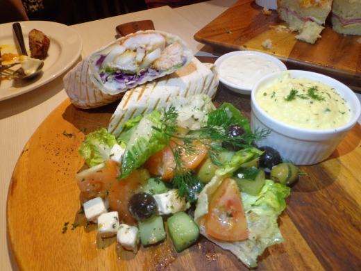Poseidon's Wrap (Greek) - Prawn, fish, squid, tomato, lettuce, scramble egg, tzatziki & Greek salad ($14.90)