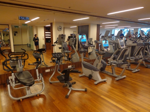 A fully equipped gym with lots of cardio machines.